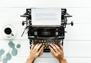 Aerial view of a man typing on a retro typewriter - My ...